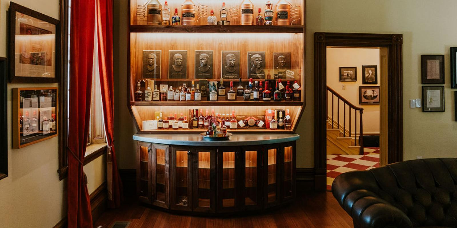 Whisky parlor featuring a custom-made bar and decades of bourbon artifacts
