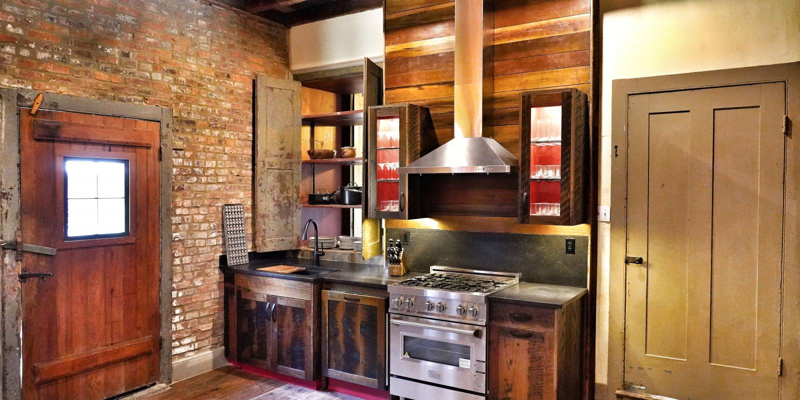 Historic-meets-modern kitchen with high-end appliances and cookware